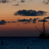 A sailboat in the sunset on                                       the island of Aruba