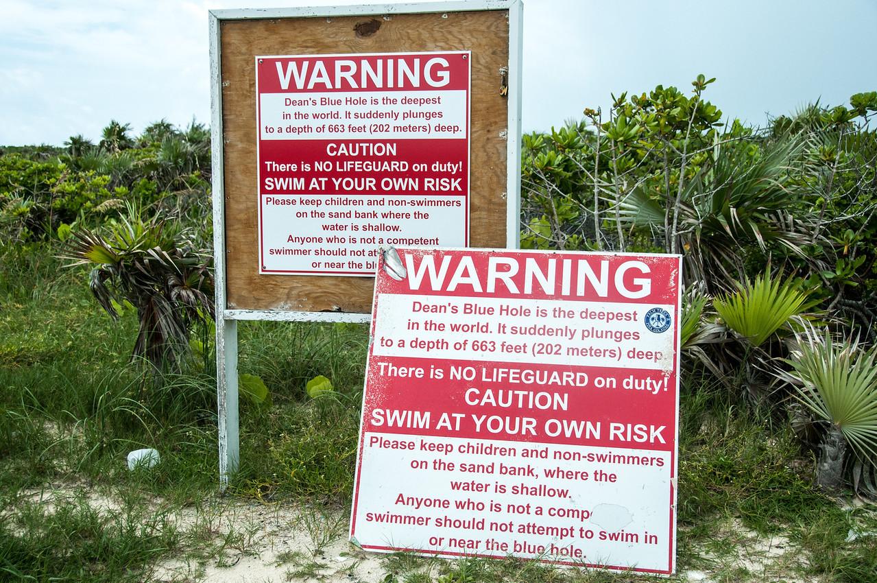 Warning signs near Dean's Blue Hole in Long Island, Bahamas