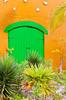 Green doors on Half Moon Cay, Bahamas, Caribbean.