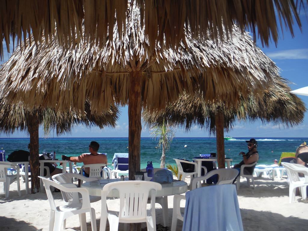 Cozumel beach club palapas with ocean view