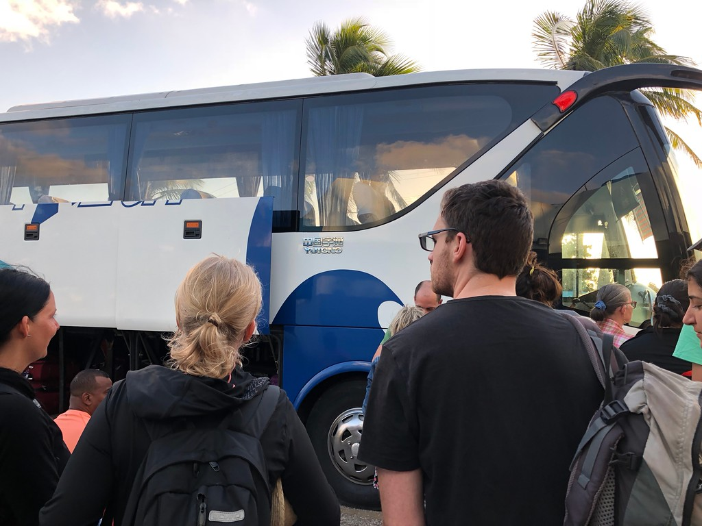 Passengers waiting in line to board the viazul bus.