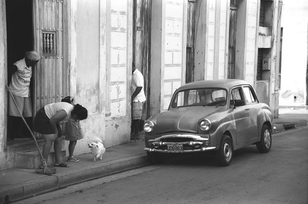 Woman Talking to a Dog - Santiago, Cuba