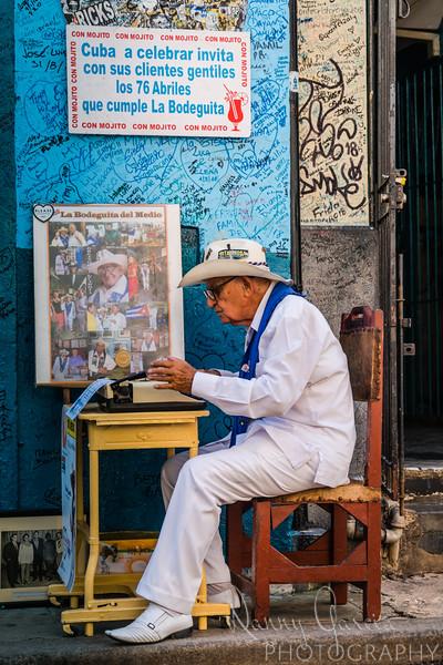 Man using typewriter in Cuba