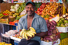 A man selling bananas at a fruit market on the Punda side in Willemstad, Curacao, Caribbean.
