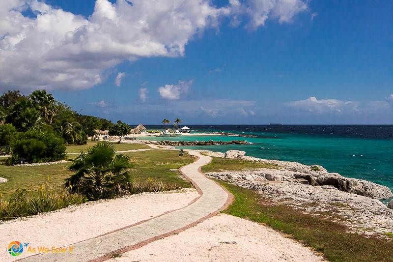 Pathway along a dry and rocky coastline shows the arid climate in Curacao