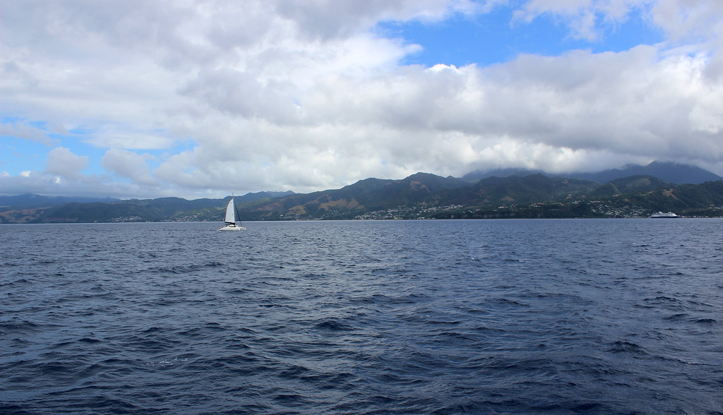 The Caribbean Sea surrounding Dominica with a sailboat