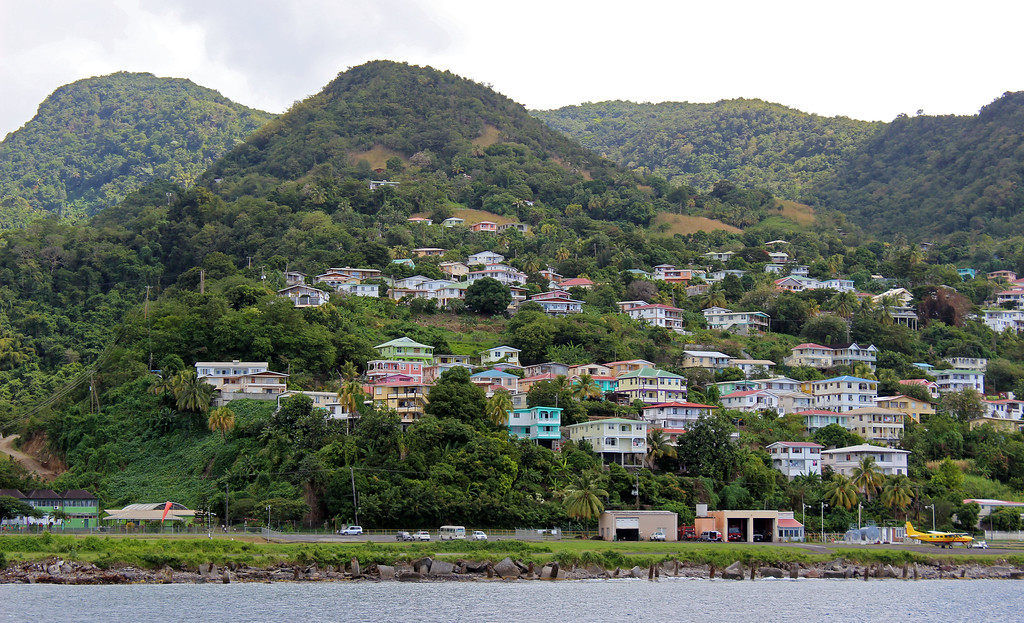 The Nature Island, Dominica, from the water. Colorful houses on the hill.