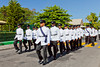 A street parade with marching band and uniformed officers in Roseau, dominica, West Indies.