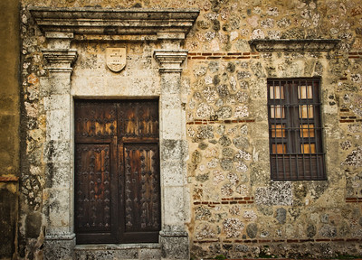 Historic wooden door and window in one of Santo Domingo's colonial buildings on Calle Las Damas