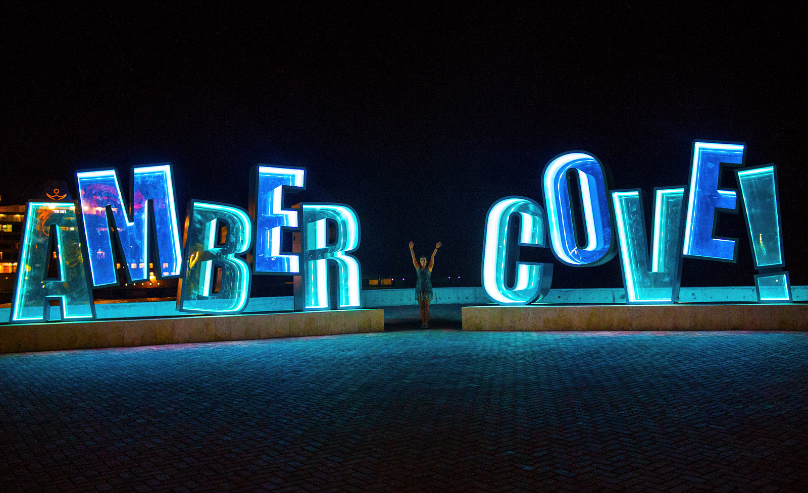 Amber Cove Dominican Republic Cruise Ship Port Guide - Amber Cove sign by night