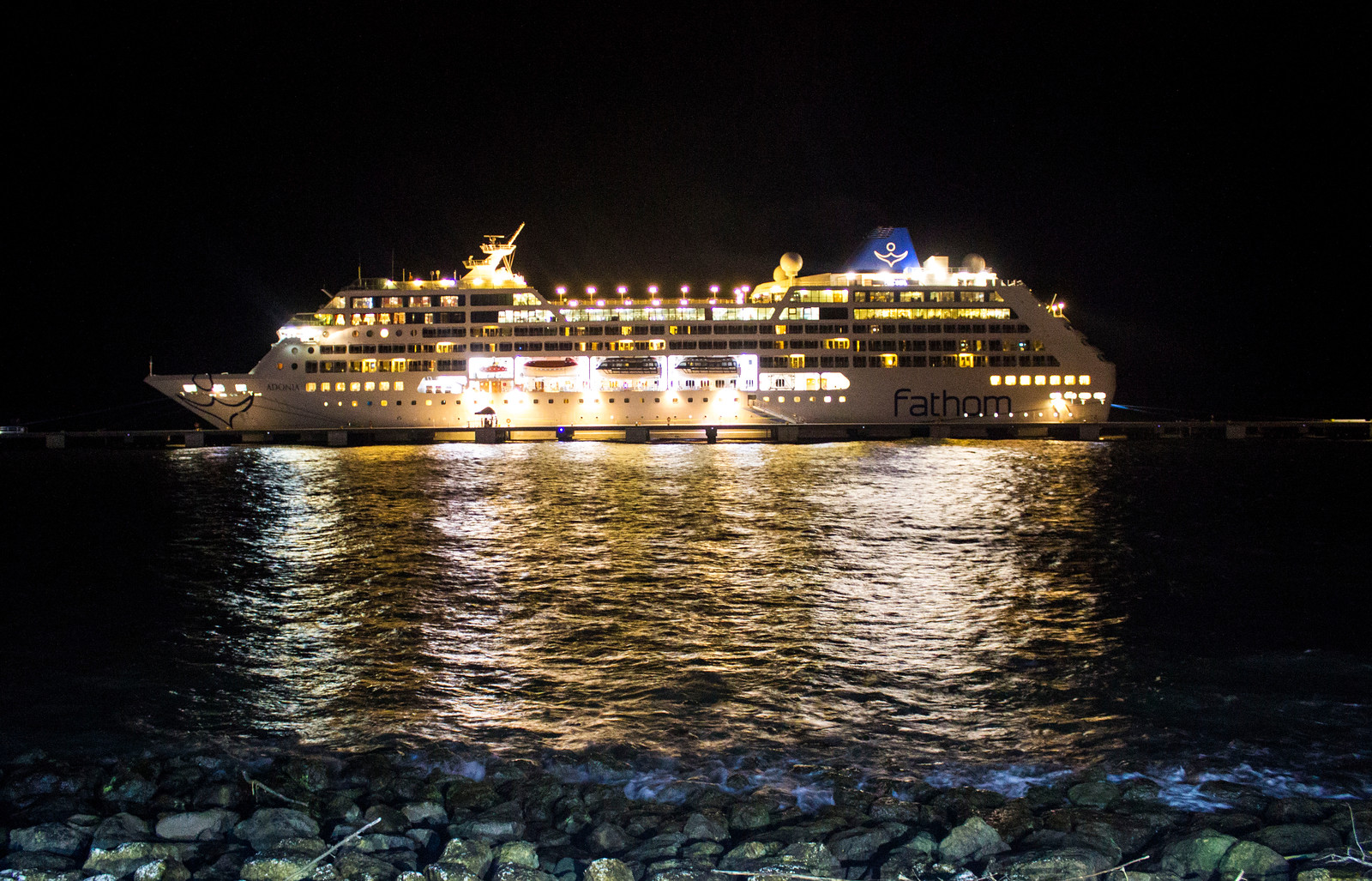 Amber Cove Dominican Republic Cruise Ship Port Guide - Fathom Cruise Ship at night all lit up