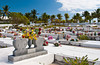 A colorful island cemetery with flowers and tombstones on the Grand Cayman Islands.