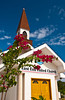 The East End United Church exterior with bougainvillea flowers on the Grand Cayman Islands.