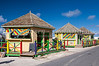 Colorful souvenir kiosks on the beach in Cockburn Town, Grand Turk Island, Turks and Caicos Islands.