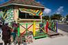 Colorful souvenir kiosks on the beach in Cockburn Town, Grand Turk Island, Turks and Caicos Islands.