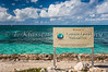 The Columbus Landfall National Park sign on the beach in Cockburn Town, Grand Turk island, Turks and Caicos Islands.