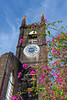 An old church steeple with bougainvillea flowers in St. George's, Grenada, West Indies.