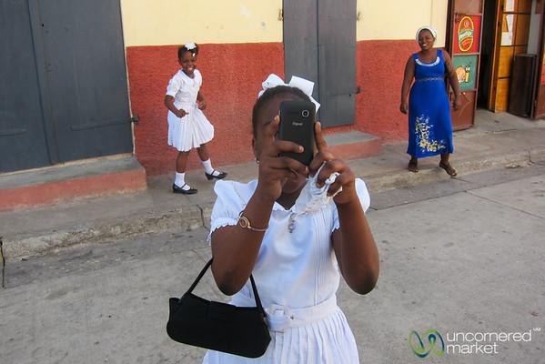 Haitian Girl Taking Photos of Us - Cap-Haïtien, Haiti