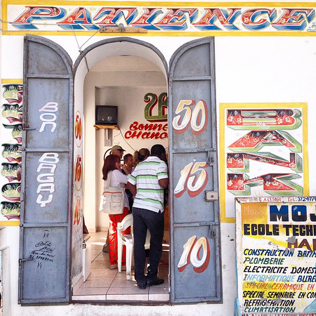 Patience! A typical bank borlette, a Haitian lottery shop. Numbers are based on the draw of the New York state lottery. This one on the supremely colorful streets of Cap-Haïtien. We played a ticket for just short of $1. If we win? Thinking we'll quit our jobs and travel the world. via Instagram http://ift.tt/1ES4qfU