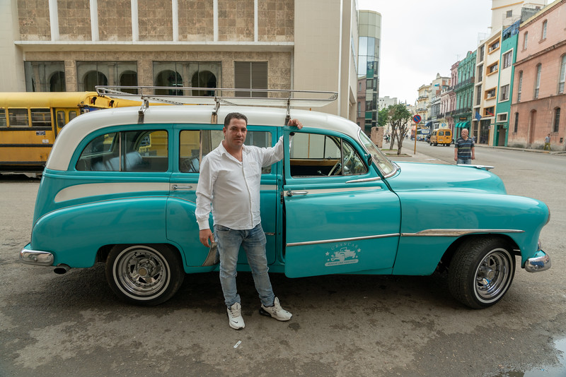 A driver and his taxi. I was told that a nice old car can sell for $30,000 to $50,000. There aren't many ways to make $25 per hour in Cuba, but this is one.