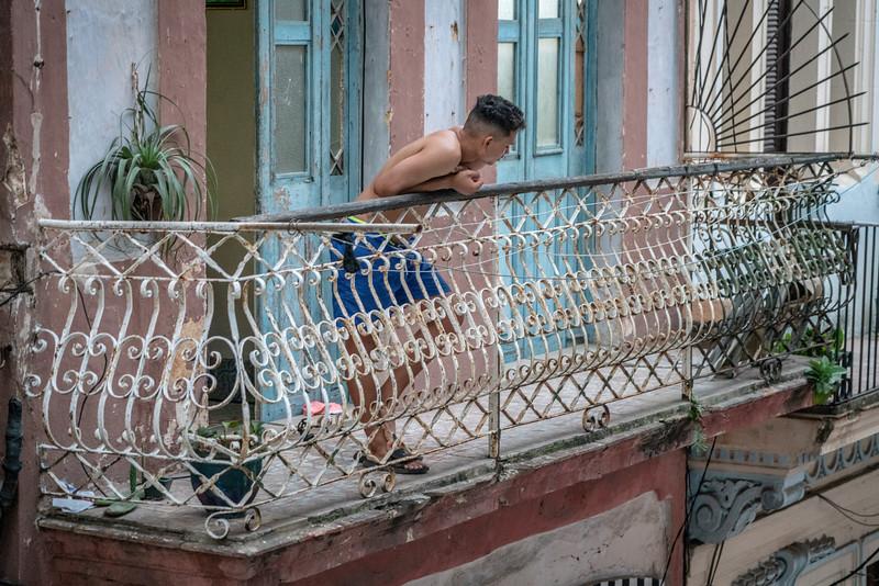 Guy on balcony, Habana Vieja.
