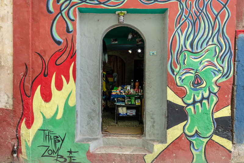 Lots of people set up informal shops in their doorways. Anything to make a little money.