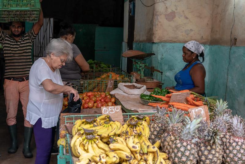 Woman in produce market.