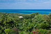 A view of the tropical island of Roatan, Honduras from an elevated viewpoint.