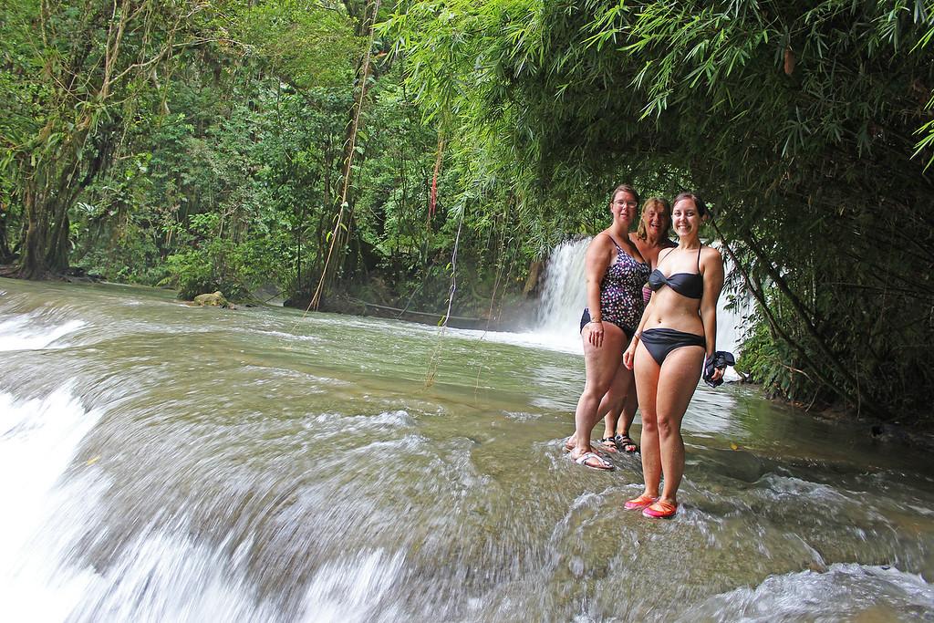 Walking across YS Falls in Jamaica