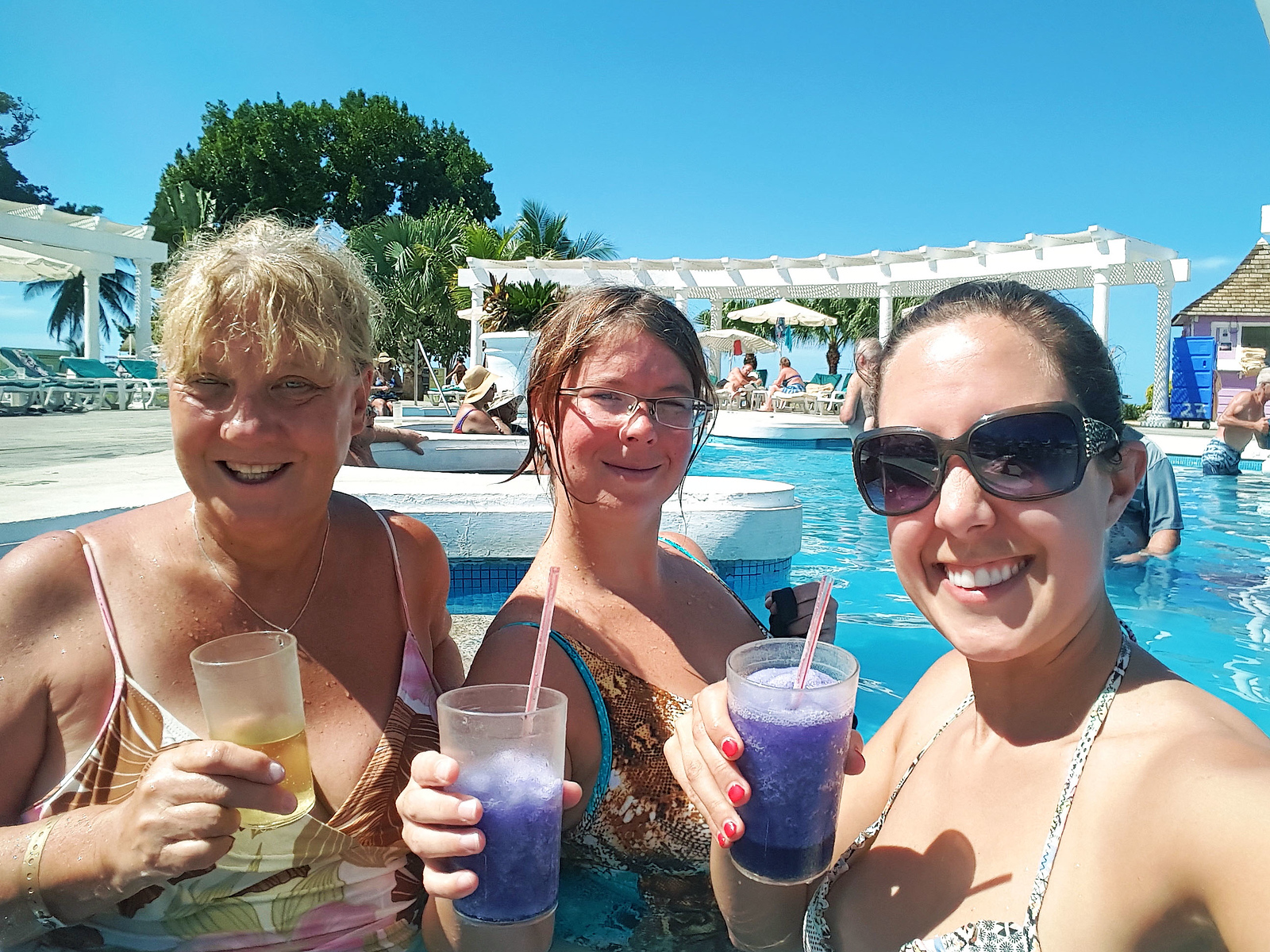 Enjoying our drinks at the resort swimming pool in Jamaica