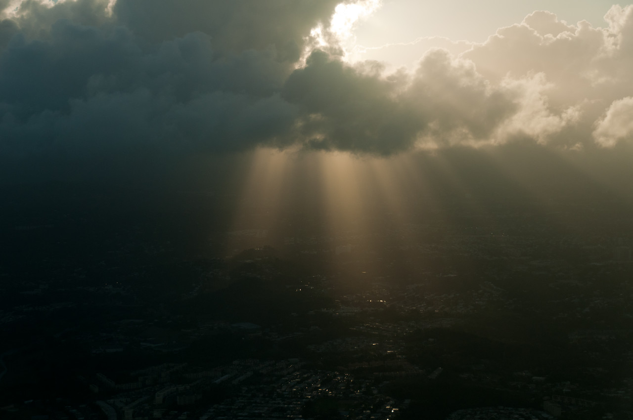 Sun rays peeking through the clouds over Puerto Rico