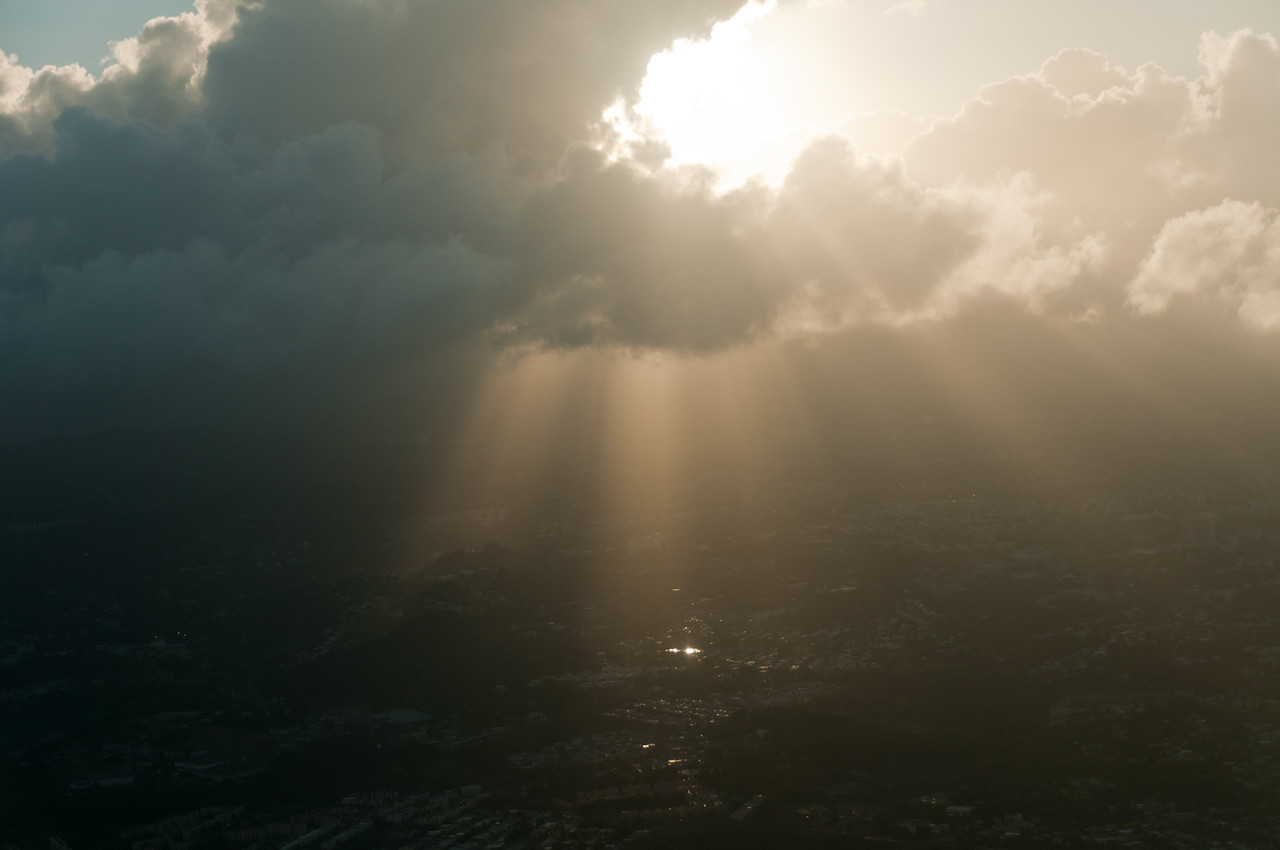 Sun rays peeking through the clouds over Puerto Rico