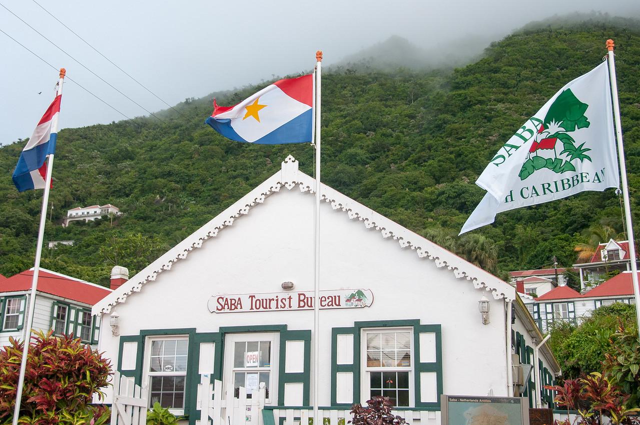 Flag in front of Saba Tourist Bureau