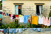 Homes with laundry drying on washlines near Marigot, Harbour, St. Lucia, Caribbean, West Indies.