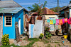 Homes with laundry drying on washlines near Marigot, Harbour, St, Lucia, Caribbean, West Indies.