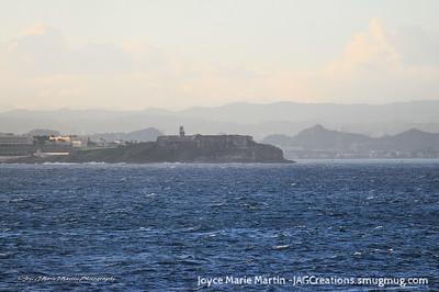 Heading into the port of San Juan, Castillo de San Felipe del Morro can be seen in the distance.