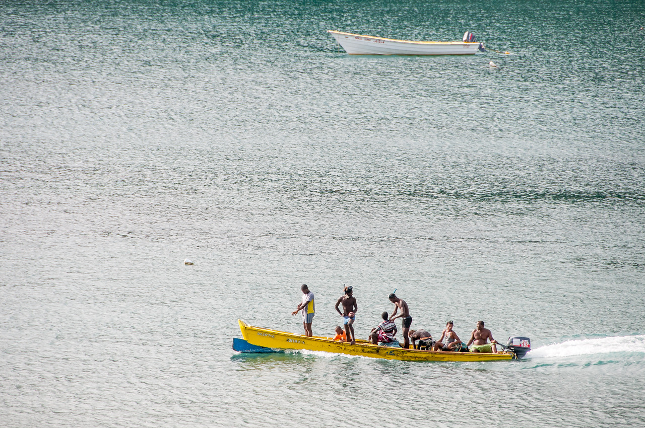 Men on a boat on the island of St. Lucia