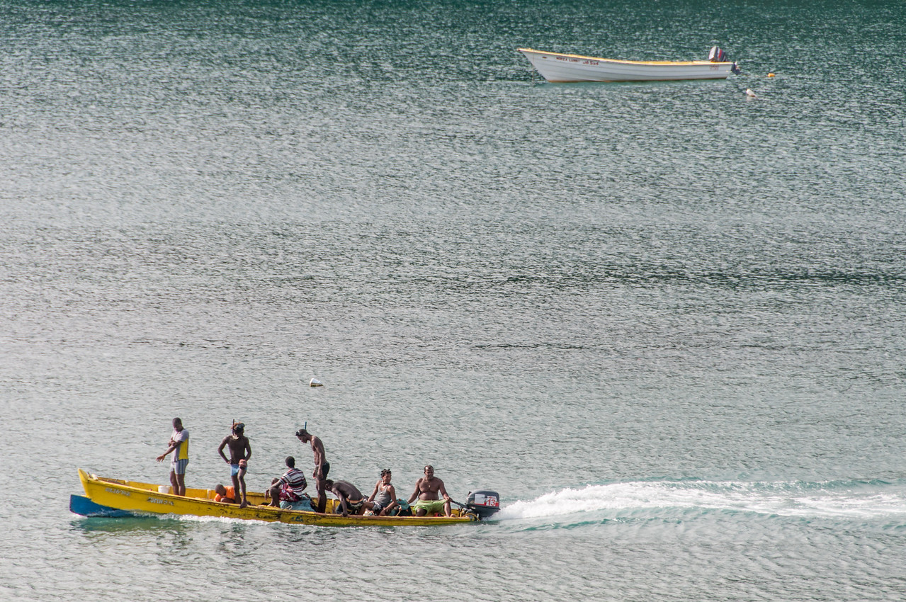 Men on boat on the island of St. Lucia