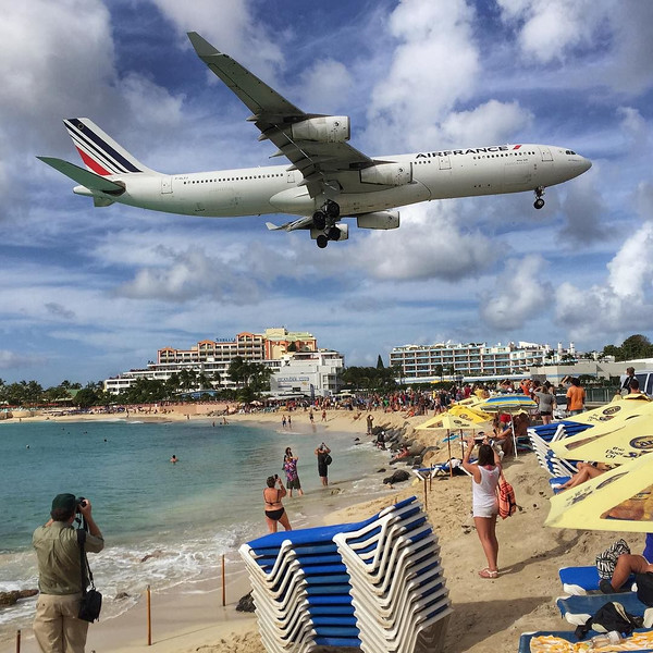 Maho Beach, St. Maarten just ahead of the Princess Juliana Airport runway. From tiny DHL mail jets to huge 747s, a continual show of dramatic landings runs right over the heads of beach goers. And this isn't even as insanely low as the planes go. Never have we seen an airport where jet landings and takeoffs are so dramatic that they are one of the main attractions. Check out the flight schedule written on the surf board at Sunset Bar and enjoy the show. #ad #ChoiceCaribbean via Instagram http://ift.tt/1OpsI3w