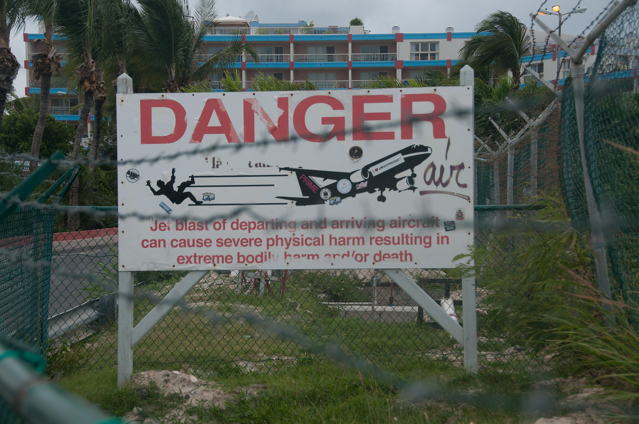 Danger sign at Maho Beach near Princess Juliana International Airport