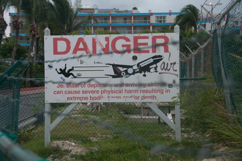 Danger sign at Maho Beach near Princess Juliana International Airport