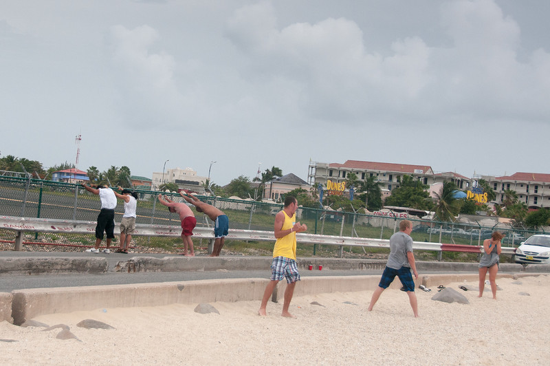 Tourists watch arriving planes in Princess Juliana International Airport