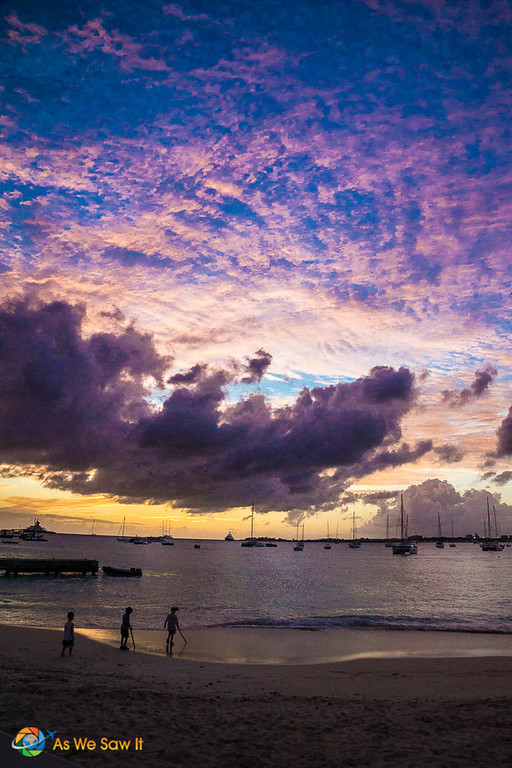 Sailboats silhouetted against a colorful sunset in St Maarten