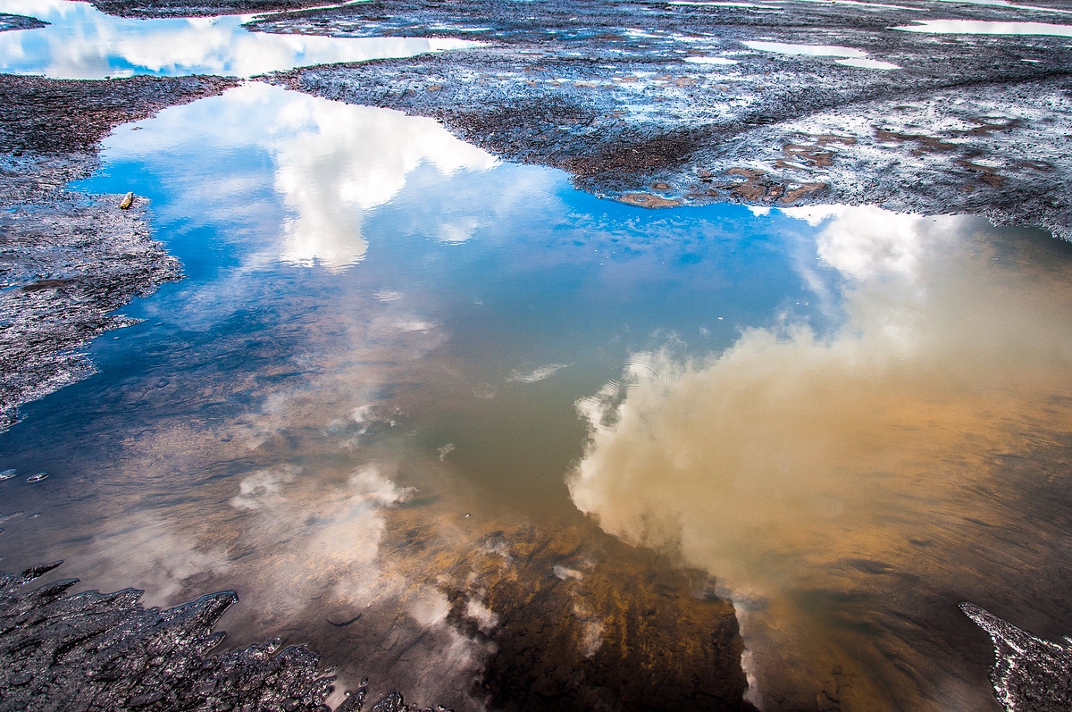 Clouds Reflected in the Water of the Pitch Lake, Trinidad