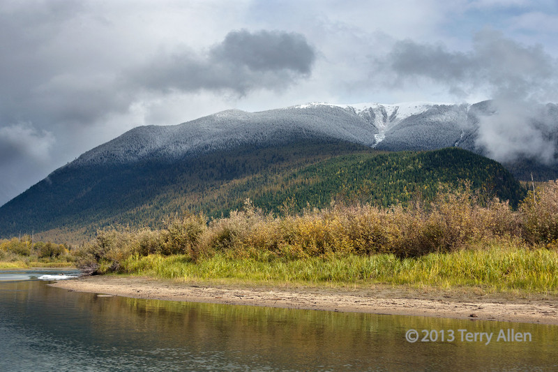 "Fall colors with fresh snow on the peaks, Mitchell River, Cariboo-Chilcotin region, British Columbia<br /> <br /> You can actually see the snow line, below which the precipitation fell as rain.  <br /> <br /> Other photos of the beautiful fall colors and the Cariboo Mountains can be seen here: <a href=""http://goo.gl/93RDeD"">http://goo.gl/93RDeD</a><br /> <br /> 25/11/13  <a href=""http://www.allenfotowild.com"">http://www.allenfotowild.com</a>"