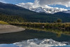 Cariboo mountains and fall colours reflected in the Mitchell River, Cariboo-Chilcotin, British Columbia