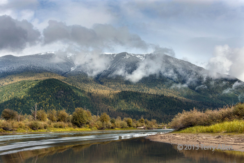 Mitchell River with fall colors and fresh snow on the Cariboo Mountains, Cariboo-Chilcotin region, British Columbia