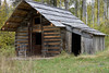 Restored log house, ghost town of Quesnel Forks, near Likely, British Columbia
