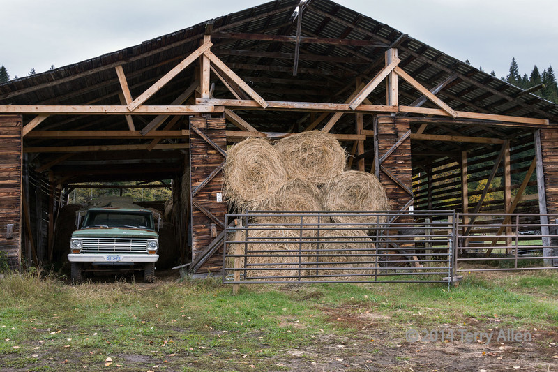 Barn with old Ford truck and hay bales, near Likely, British Colulmbi