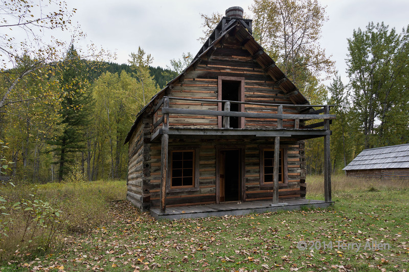 Restored Chee-Kung-Tong house, ghost town of Quesnel Forks, near Likely, British Columbia<br /> <br /> You may have noticed a number of Chinese names on the grave markers in the cemetery. Following the discovery of gold deposits along the Fraser River, on 18 June 1858, the first group of 300 American Chinese arrived in British Columbia, mostly coming from Guangdong province via San Franciso. They took jobs as miners in the gold fields, and as merchants to the growing community. More came to Quesnel Falls in 1885 after their dismissal upon completion of the Canadian Pacific Railway.  The Hongmen of San Francisco, renamed Chee Kung Tong  in 1876, established a tong in Quesnel Forks in 1859.  The tongs were benevolent secret societies devoted to mutual aid and in Quesnel Forks focused on establishing rules of conduct in the gold fields.  Eventually they were renamed the Chinese Freemasons and became politically active, e.g., as the Kuomingtang in Taiwan (Quo Min Tong).